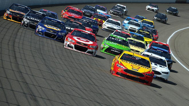 Joey Logano leads the pack at the FireKeepers 400. Logano led for 140 of the 200 laps in his No. 22 Ford for Team Penske.