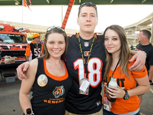 Cincinnati Bengals fans geared up for a preseason game against the Indianapolis Colts at Paul Brown Stadium. Ashley Crowder of Anderson and Marshall Howard and Nicolette Keisor of Amelia.