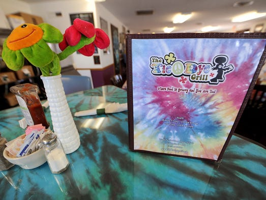 The menu sits on a table at the Tie Dye Grill, Wednesday, February 12, 2014, at 1311 N. Shadeland Avenue in Indianapolis.