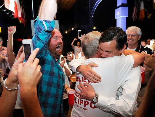 Supporters cheer as Scott Flippo hugs his father, Pat Flippo, after learning he won the District 17 Senate seat Tuesday evening.