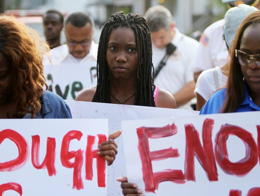 Janiyyah (CQ) Jones, age 13, participates in a peace march, Thursday, August 21, 2014, through the streets of Plainfield, NJ. Photo by Jason Towlen