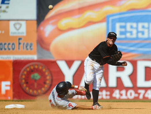 Shorebirds second baseman Justin Viele throws to first after making the play at second to turn the double on Sunday afternoon against the Lakewood Blue Claws at Arthur W. Perdue Stadium in Salisbury.