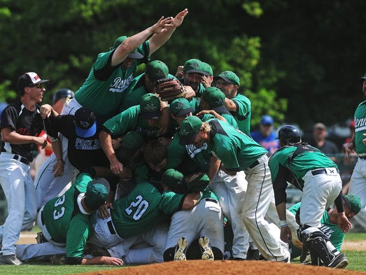 The Renner Monarchs celebrate after defeating the Vermillion Red Sox in the State Amateur Baseball Tournament class A Championship game on Sunday, Aug. 17, 2014, at Cadwell Park in Mitchell, S.D.