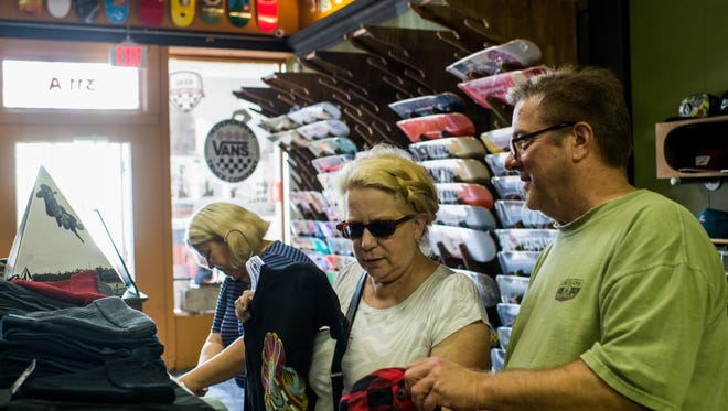Lark Chartier and her husband Bill Chartier shop at Rukus in Lafayette, La., on Small Business Saturday on Saturday, Nov. 28, 2015. Small Business Saturday, which serves as an alternative to the Black Friday shopping event, is intended to encourage shoppers to purchase goods and services from locally-owned small businesses.