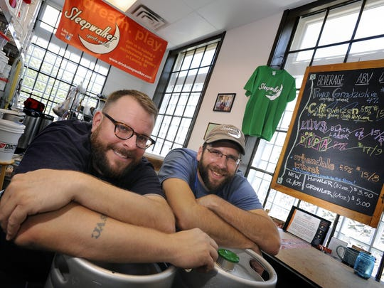 Jeremy Sprague, left, and Matt Jason, opened Sleepwalker Spirits and Ales in September 2104 inside the Allen Market Place. They have now outgrown the incubator and will be opening a micropub in a nearby storefront this summer.