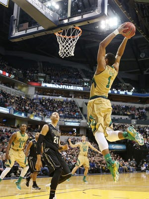 Notre Dame forward Austin Torres (1) dunks against Purdue during the Crossroads Classic at Bankers Life Fieldhouse. Notre Dame won 94-63.