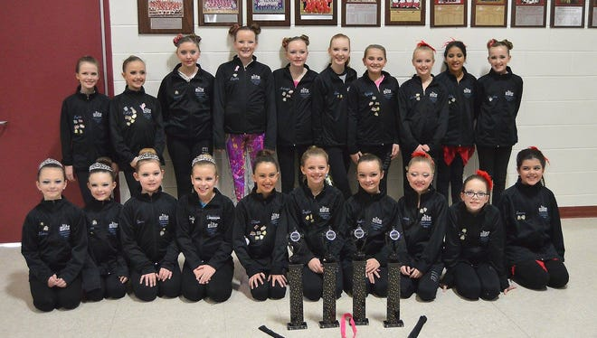 The Junior Elite Competition Team from In Motion Dance Studio poses with trophies and other awards won at last month's Starbound Competition in Middleton. Pictured, in front, is Elaine Thiel, Lauren Niewolny, Tessa Kuplic, Emily Machovec, Olivia Ramos, Taylor Miller, Madison Ullman, Alaina Arnold, Claudia Leibham and Emma Hollister; back: Sophie Bast, Kaitlyn Kurtz, Kieanna LePage, Sophia Suchocki, Makayla Ullman, Claire O'Dwanny, Kyleigh Kroll, Lauren Olig, Calyssa Hall and Ella Hogue.