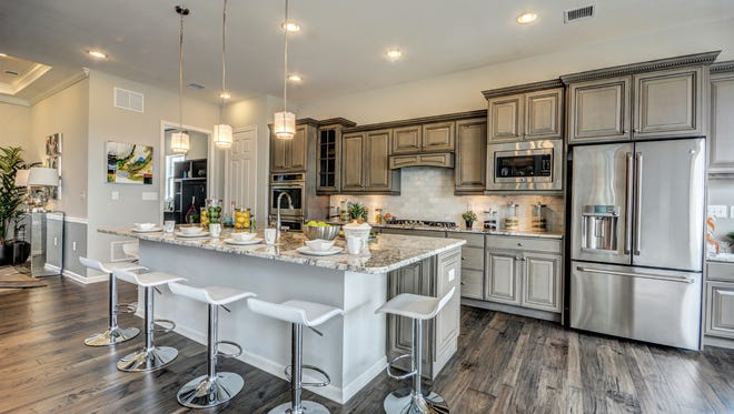 The Ibiza model at K. Hovnanian's Four Seasons at  Monroe has an open floor plan with a center-island kitchen.