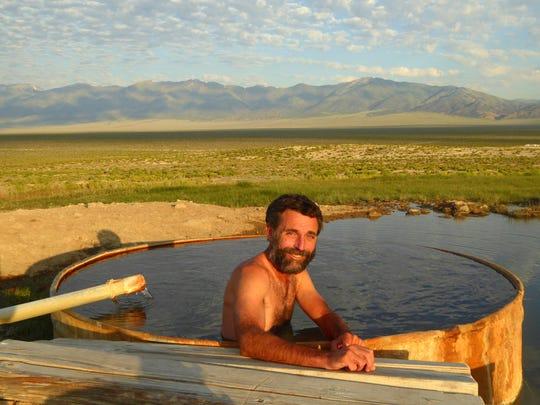 Hiker Bernie Krausse of Winthrop, Wash., at Spencer Hot Spring in Nevada.
