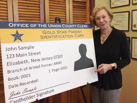 Union County Clerk Joanne Rajoppi displays a sample of the new Gold Star Parent card.