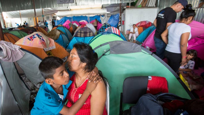 Manuela Candelaria Solano holds her young son at the Juventud 2000 migrant shelter in Tijuana, Mexico on June 20, 2018. Solano lost her husband to narco-violence in the Mexican state of Guerrero.