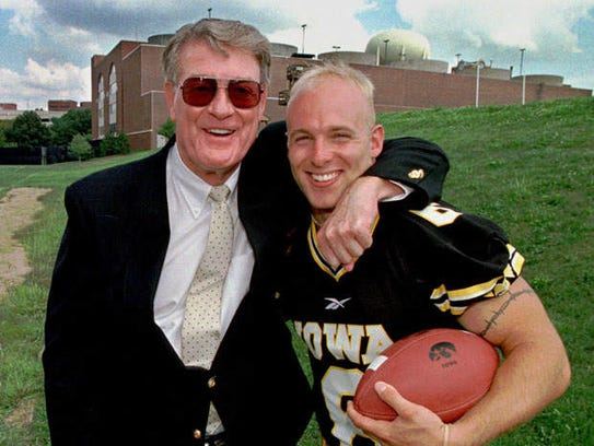 Fry and player Tim Dwight pal around during the Hawkeyes'