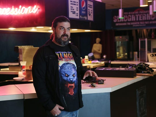 "Ben Dixon stands in front of the concession area of the Courtyard Cinemas building he purchased to open a tattoo parlor, haunted house and smaller theater. ""Owning a movie theater is just something I always thought about,"" he said. ""I was pretty adamant."""
