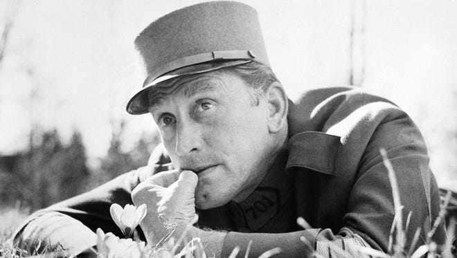 """Kirk Douglas, shown near Munich, Germany, where he starred in """"Paths of Glory."""" The 1957 film directed by Stanley Kubrick was based on Humphrey Cobb's famous novel of a mutiny in the French Army during World War I."""