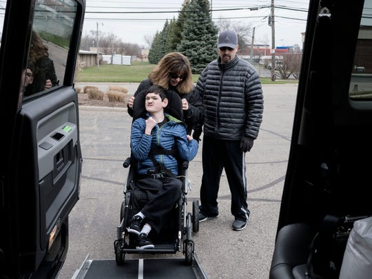 Marc, right, and Sandra McKenzie wheel their son Jordan, 13, into their new Mobility Ventures MV-1 vehicle on Saturday, Mar. 26, 2016, in Redford.
