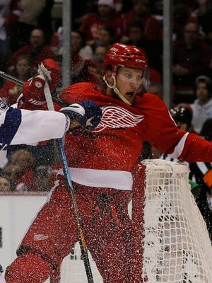 Red Wings forward Justin Abdelkader is shoved into Tampa Bay's goal by Braydon Coburn, who was called for the interference penalty, in the second period of the Wings' 3-0 Game 3 win Tuesday at Joe Louis Arena.