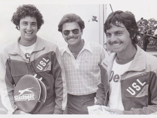 Former UL tennis coach Jerry Simmons, center, - shown