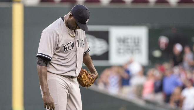 New York Yankees starting pitcher Michael Pineda (35) looks down after giving up a two run home to Minnesota Twins designated hitter Miguel Sano in the first inning at Target Field.