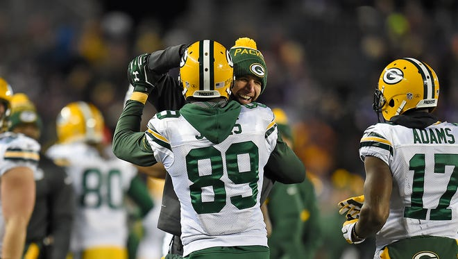 Green Bay Packers receiver Jordy Nelson congratulates James Jones after Jones made a touchdown catch against the Minnesota Vikings in the fourth quarter during Sunday's game at TCF Bank Stadium in Minneapolis, Minn.