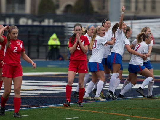 Wall celebrates as they win 4-3  in overtime in final against Westwood Regional. Wall Girls Soccer defeats Westwood Regional in onetime during the  NJSIAA Girls Group II State Soccer Championship final at Kean University on November 18, 2017.
