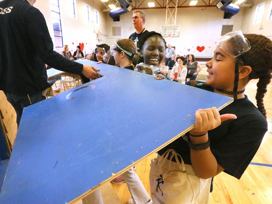 Fifth-graders Amy Luwaja and Ah'Tiana Woods place the