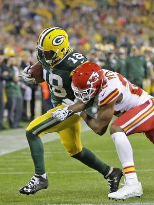 Green Bay Packers wide receiver Randall Cobb (18) scores a touchdown against the Kansas City Chiefs at Lambeau Field.