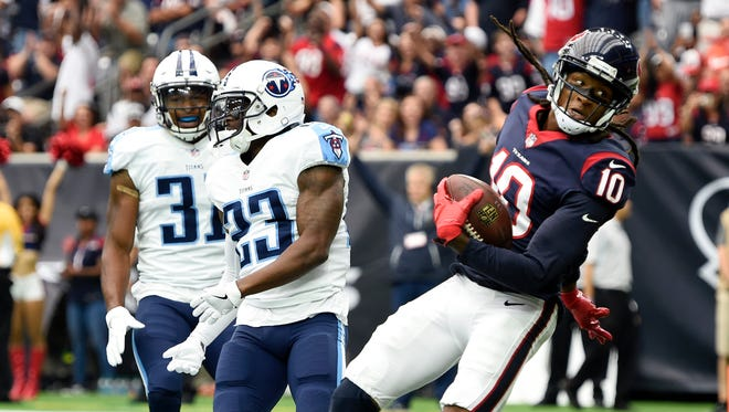 Texans wide receiver DeAndre Hopkins (10) scores a touchdown over Titans safety Kevin Byard (31) and  cornerback Brice McCain (23) to make the score, 14-0, during the first quarter at NRG Stadium  Sunday, Oct. 1, 2017 in Houston, Texas.