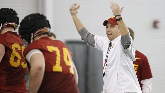 Head football coach Matt Campbell leads players on the field Tuesday, March 8, 2016, during spring practice in the Bergstrom Football Complex at Iowa State University in Ames.