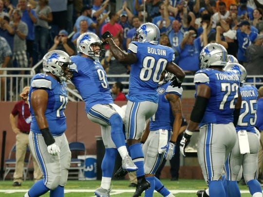 Lions quarterback Matthew Stafford and receiver Anquan Boldin celebrate Boldin's first-quarter TD against the Titans on Sept. 18, 2016 at Ford Field.