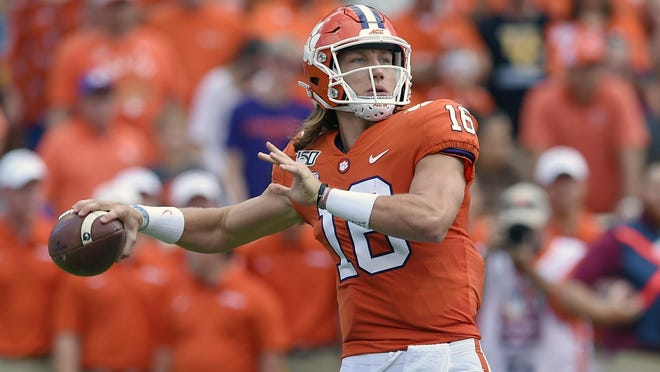FILE - In this Oct. 12, 2019, file photo, Clemson's Trevor Lawrence throws a pass during the first half of an NCAA college football game against Florida State, in Clemson, S.C. Lawrence is a candidate for the 2020 Heisman Trophy award.