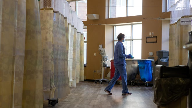 Staff members monitor patients in a corridor of Stormont Vail Hospital converted into hospital rooms Wednesday afternoon as an influx of COVID-19 patients filled portions of the hospital.