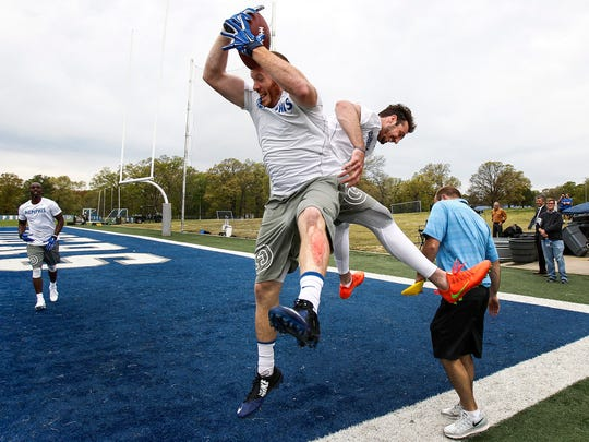 April 6, 2016 - Former University of Memphis football players Alan Cross (left) and Paxton Lynch (right) celebrate after the football team-s pro day in front of NFL scouts Wednesday morning. Lynch completed 57 of 69 passes in windy conditions.