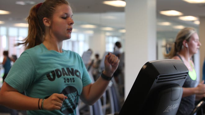 Annie Garner runs on a treadmill while taking part in the Move It Delaware campaign.
