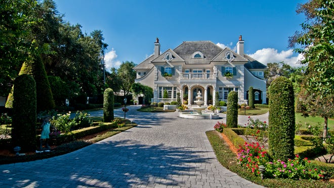 The Farmer residence on North Riverside Drive in Indialantic is very lush yet tailored.