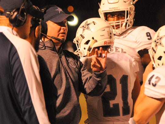 Seigel coach Michael Copley talks to players during