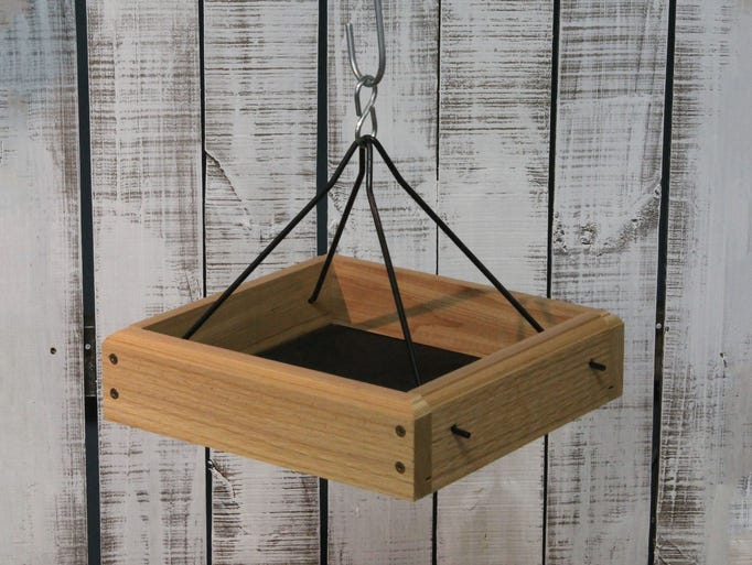 Some tray feeders are made to be hung, some are designed