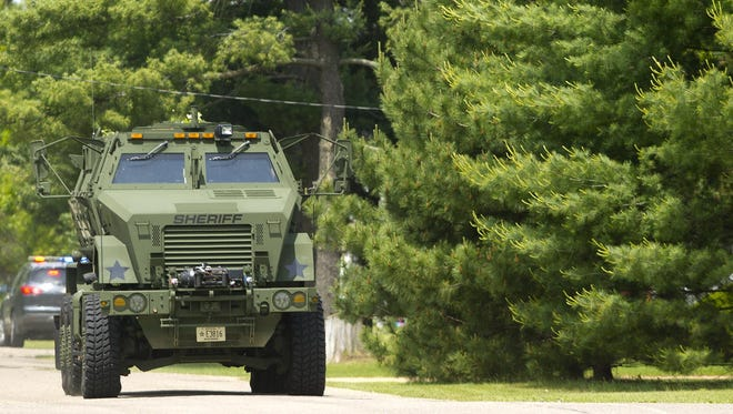 The Portage County Sheriff's Office's armored vehicle makes its way down Klondyke Street during a standoff in Bancroft, Wednesday, June 3, 2015.