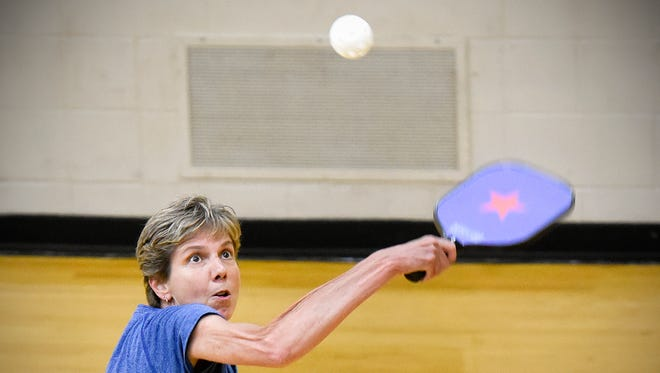 Lisa Arndt, Golden Valley, races back to return the ball during her pickleball match in the Minnesota Senior Games on Friday, May 20, at the Whitney Recreation Center.