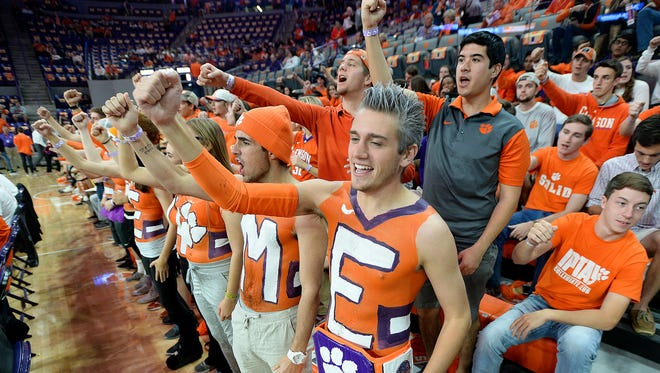 Clemson student Peter Rowan, right, cheers as the Tigers take the court on Friday, November 11,  2016 at Clemson's Littlejohn Coliseum