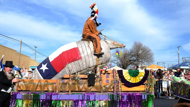 A man rides an giant armadillo at the Nocona Mardi Gras parade Saturday, Feb. 18, 2017, in Nocona along Clay Street.