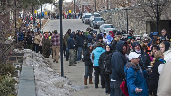 More than 1,000 people line up at the Costello Courthouse in Burlington on Friday, March 20, 2015, for Driver Restoration Day. The pilot program allowed Vermonters in certain counties to pay off old parking tickets.