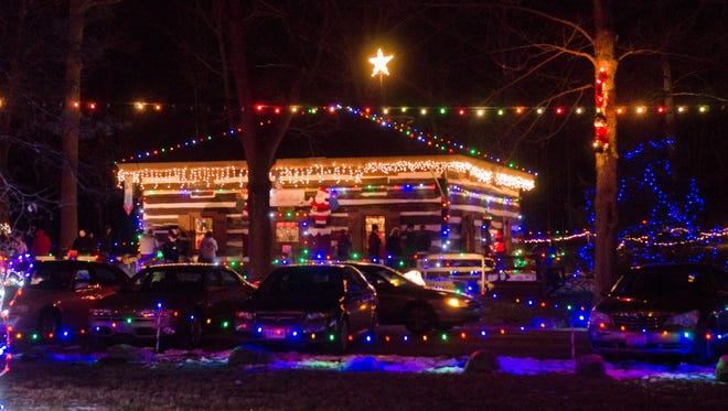 Whispering Christmas, a drive-by display featuring thousands of light strands and several family activities, is shown from 2016.