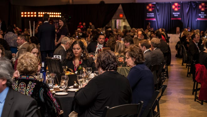 Attendees chat during dinner at the Wayne County Area Chamber of Commerce's annual awards dinner at the Wayne County Fairgrounds' Kuhlman Center on Friday, Jan. 19, 2018.
