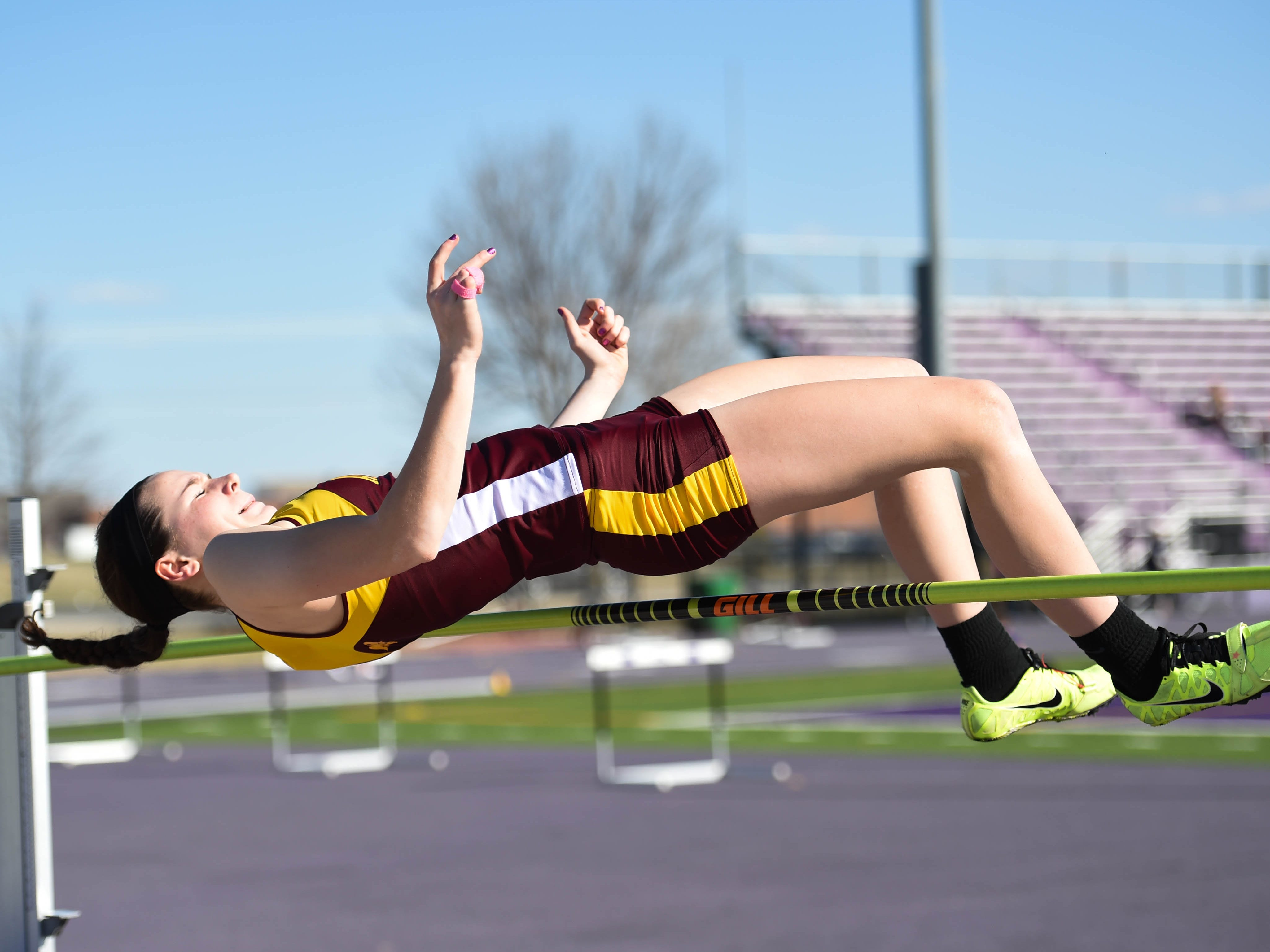 Ankeny's Alyssa Mulcahy, a junior, grimaces as she waits to see if she cleared the bar at the Waukee Invitational track meet on March 31.