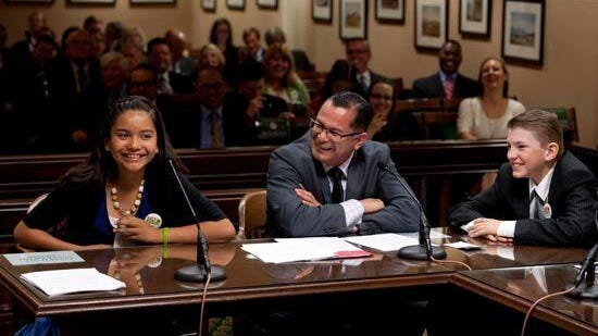Fifth-graders Freedom Payne and Samantha Lambarena testified before the State Assembly Committee on Water, Parks and Wildlife in support of a bill that would declare the red-legged frog the official state amphibian.