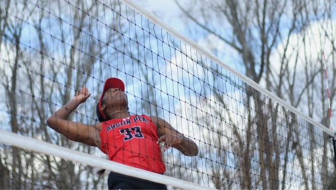 Ashley Slay goes up for a hit during Austin Peay beach volleyball's practice at Nashville Beach in Joelton on Friday, Feb. 24.