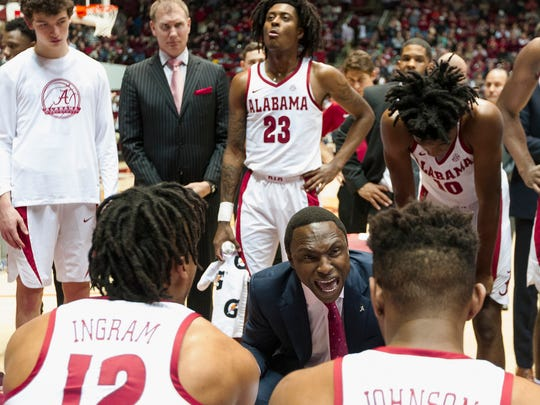 Alabama coach Avery Johnson talks to his team during the first half of an NCAA college basketball game against Auburn on Wednesday, Jan. 17, 2018, in Tuscaloosa, Ala. (AP Photo/Laura Chramer)