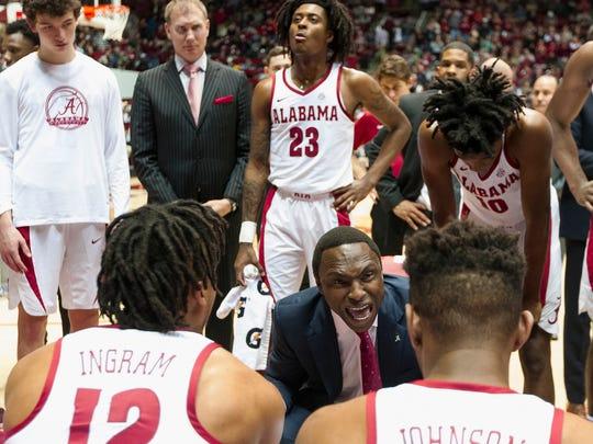 Alabama coach Avery Johnson talks to his team during