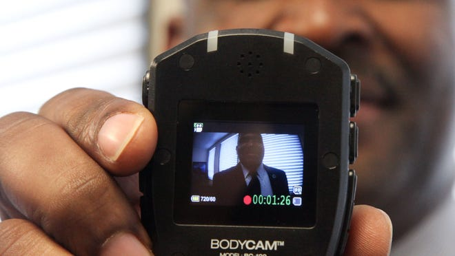 A body camera is held by Quentin Holmes, the chief of police in Monroe, Louisiana, on Dec. 1. The case of a black South Carolina man fatally shot by a white police officer has revived discussions about law enforcement body cameras.