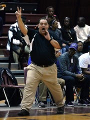 North Webster head coach Rodney Thrash calls out to